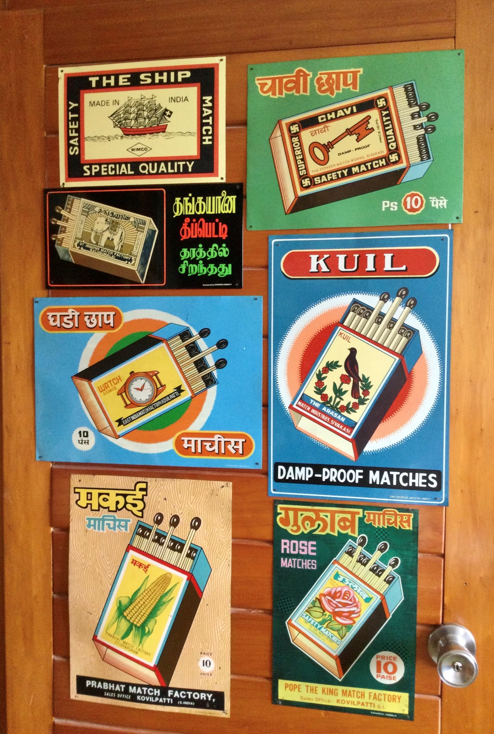 Indian Tin Match adverts on the door of my study