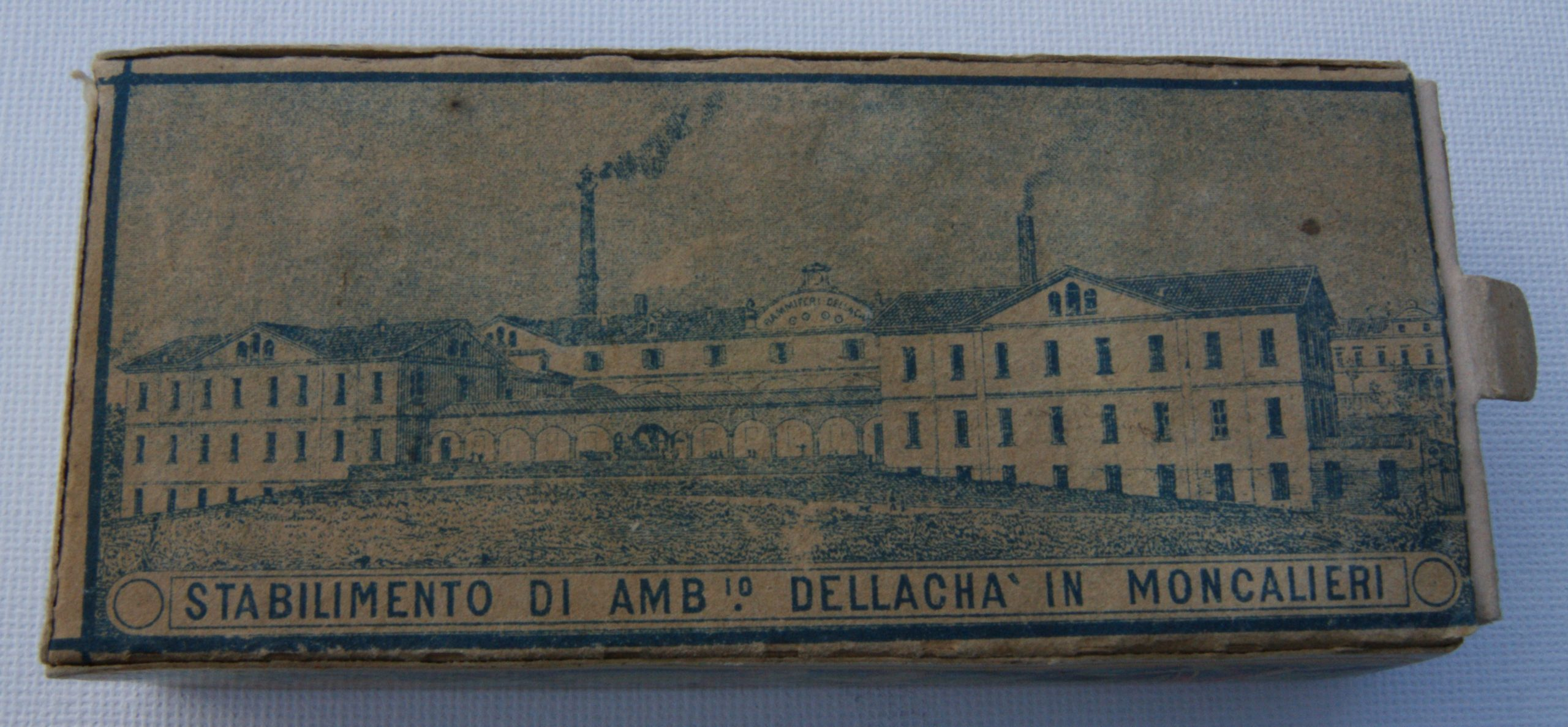 A. Dellacha box (view showing the underside of the matchbox)